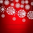 Christmas red background with snowflakes pattern. — Stock Vector #31397019