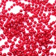 Christmas decoration. Red beads isolated on white background — Stock Photo