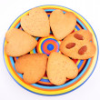 Homemade heart shaped biscuits on varicoloured dish, isolated on white background. Christmas cookies — Stock Photo #31342545