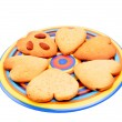 Homemade heart shaped biscuits on varicoloured dish, isolated on white background. Christmas cookies — Stock Photo #31342563