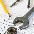 Tools and mechanisms detail on the background of engineer drawings — Stock fotografie