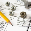 Foto Stock: Tools and mechanisms detail on the background of engineer drawings
