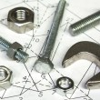 Spanner and nuts over technical drawing,mechanic concept — Stock Photo