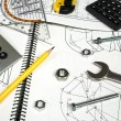 Calculator and measuring equipment with nuts on technical drawing — Foto de Stock