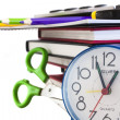 School composition,clock,colour pencils scissors and books, isolated on white — Stock Photo