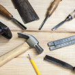 Joiner tools,hammer chisel and meter on wood table background — Stock Photo