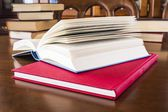 Many different sized colored and shaped books on wood table — Stock Photo