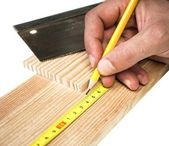 Carpenter working with pencil meter and wooden board — Stock Photo