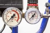 Industrial barometer in blue air compressors,white background — Stock Photo