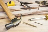 Carpenter tools,hammer,meter and screw-driver on construction background — Stock Photo
