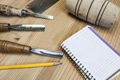 Joiner tools with paper,chisel and hammer on wood table background — Stock Photo
