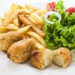 Stock Photo: Portuguese codfish cake with french fries and vegetables