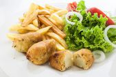 Portuguese codfish cake with french fries and vegetables — Stock Photo