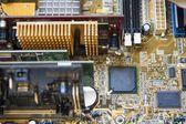 Electronic microcircuit with microchips and capacitors — Stock Photo