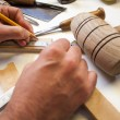 Woodworker with pencil measuring — Stock Photo #14407585