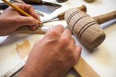 Woodworker with pencil measuring — Stockfoto