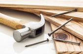 Wood planks with hammer — Stock Photo