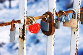 Padlock in the form of heart on the bridge of love — Stock Photo