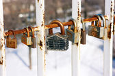 Padlock in the form of a house on the bridge of love — Stock Photo