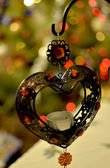 Iron heart with New Year lights — Stock Photo