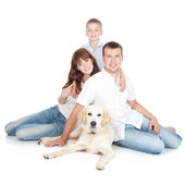A young family with a dog — Stock Photo