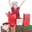 Pretty little girl in santa helper hat with gifts on white — Stock Photo #12853277