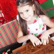 Stock Photo: Little girl making Christmas cookies