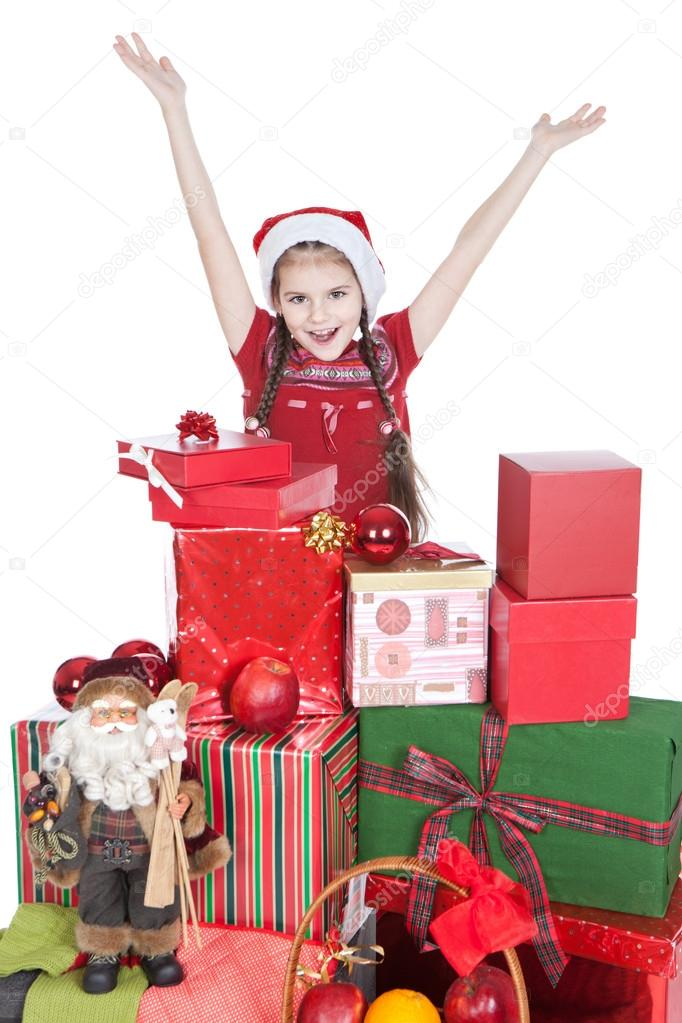 Beautiful smiling little girl in Santa's Helper hat with gifts over white — Stock Photo #12853277