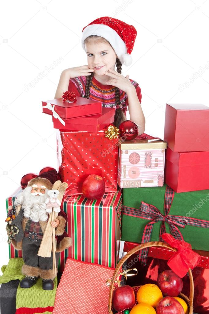 Beautiful smiling little girl in Santa&#039;s Helper hat with gifts over white  Stock Photo #12856881