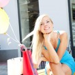 Foto Stock: Young beautiful girl relaxing after shopping
