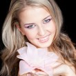 Stock Photo: Beautiful blond girl with big pink flower in hands