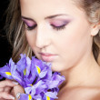 bright closeup portrait of beautiful woman with violet flowers — Stock Photo