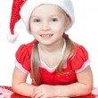 Royalty-Free Stock Photo: Pretty little girl in santa helper hat with gift on white