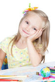 Little blonde girl in school at the desk — Stock Photo