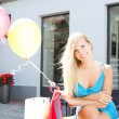 Young beautiful blonde girl relaxing after shopping outdoors — 图库照片
