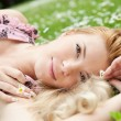 Young woman relaxing on a meadow — Stock Photo #15856389