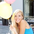 Happy girl with balloons — Stock Photo #15856407