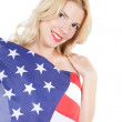 Happy young woman wearing american flag — Stock Photo #15856489