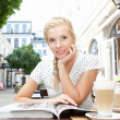 Beautiful blonde woman sitting in street cafe — Stock Photo