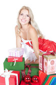 Young beautiful blonde woman with gift boxes over white — Stock Photo