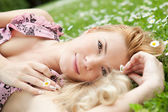 Young woman relaxing on a meadow — Foto Stock