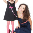 Stock Photo: Happy mother and her funny little girl over white