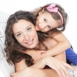 Stock Photo: Happy mother with little daughter