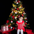Stock Photo: Happy little girl with Christmas gifts