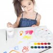 Little brunette girl drawing at the desk — Stock Photo #16021597
