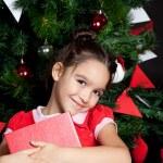 Lovely little girl at Christmas time — Stock Photo