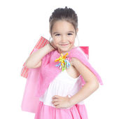 Little smiling girl with shopping bags over white — Stock Photo