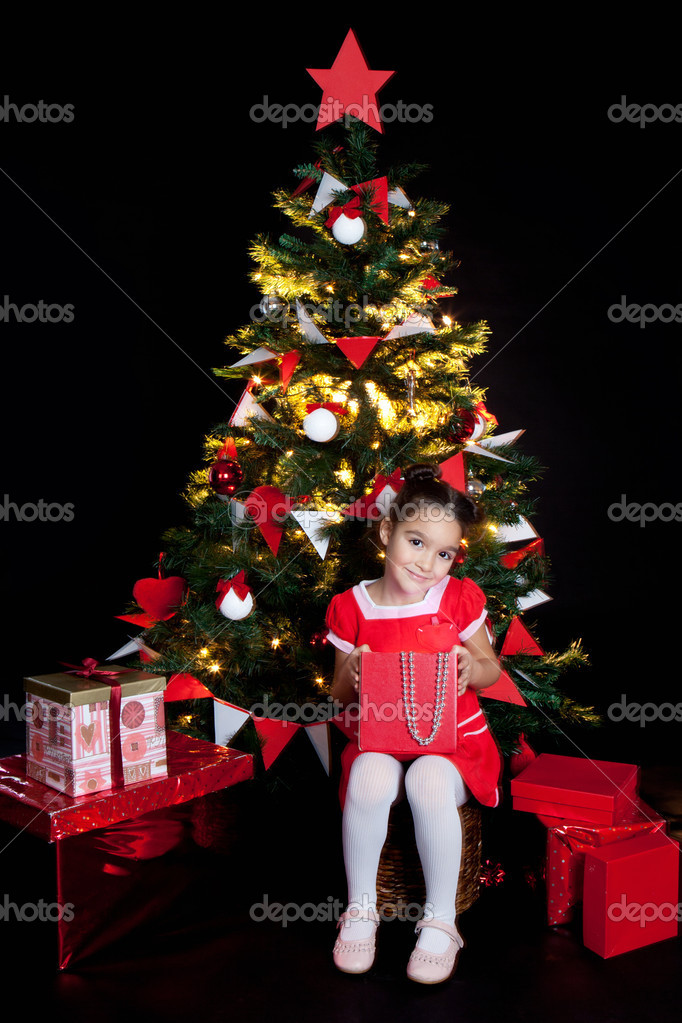 Little smilind girl with red gifts at Christmas night   Stock fotografie #16021555