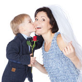 Cut boy groom kissing his cheerful mother bride over white — Foto Stock