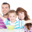 Happy family having breakfast - Stock Photo